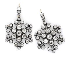 A Pair of Antique Diamond Snowflake Ear Pendants, Convertible into Brooches, circa 1880. Available at FD.  www.fd-inspired.com
