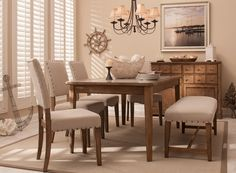 The Gray Street 6-piece dining set looks custom designed with its unique concrete composite tabletop inlay, weathered wood finish and mixed seating.