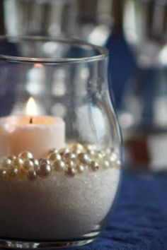 Photo courtesy of Kim Candles and pearls make the perfect centerpiece for a wedding or wedding shower especially if you are planning a winter wonderland theme wedding. Small candles, faux pearls in a Pearl Centerpiece, Candle Centerpieces, Centerpiece Ideas, Simple Centerpieces, Pearl Wedding Centerpieces, Candle Decorations, Graduation Centerpiece, Winter Centerpieces, Quinceanera Centerpieces