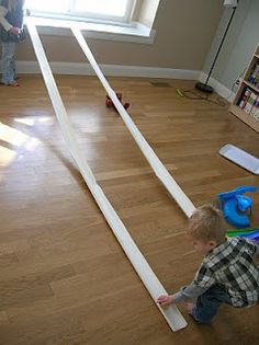 Rain gutter cut in half to make a match box car track. Simple, cheap and fun for the kids! Nico would love this!