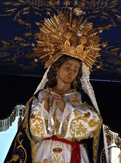 Virgen de Amor HermosoOn Easter Sunday the Virgin of Beautiful Love is carried around the streets of Cartagena in Spain.The climax of the procession is when Mary meets her Son, who has risen from the grave.