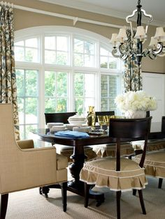 The formal dining room is the only space that's totally separate in the main living area. Used primarily in the evening for formal entertaining, the room nonetheless is radiant with natural light. Dining Room Drapes, Dining Room Windows, Dining Table Chairs, Dining Room Design, Wood Chairs, Dining Rooms, Kitchen Dining, Kitchen Chair Cushions, Slipcovers For Chairs