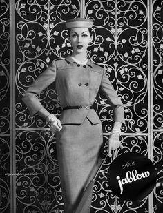 Dovima wearing a suit by Arthur Jablow, 1956.