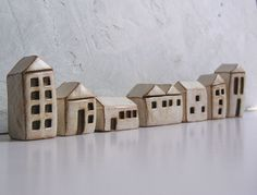http://www.etsy.com/listing/102968991/handmade-polymer-clay-houses-set-of-7?ref=sr_gallery_32_ex=etsy_finds_utm_source=etsy_finds_utm_medium=email_utm_campaign=etsy_finds_100612_2705891615_0__user_id=19152040_link_clicked=2_redirect=1_filters=ceramics_and_pottery+miniature_page=5_search_type=all_view_type=gallery#Handmade polymer clay houses ... instant little neighborhood