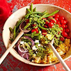 This Mexican-inspired summer salad combines the best flavors of the season! Get the full recipe here: http://www.bhg.com/recipes/salads/tomato/our-best-tomato-salad-recipes/?socsrc=bhgpin081014greenbeancorntomatosalad&page=3