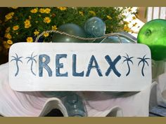 """""""RELAX"""" COTTAGE/BEACH SIGN.  Very Beach/Cottage style """"Relax"""" sign, rustic white & blue coastal color. Each piece has been hand carved and hand painted with great attention to details. Measures 14""""  Item: ORT1706435  www.makanahut.com"""