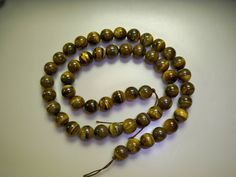 Natural Round Tiger's Eye Beads - Protection - 16 Inch Strand - Elva: http://www.outbid.com/auctions/17692-supplies-for-creations#13