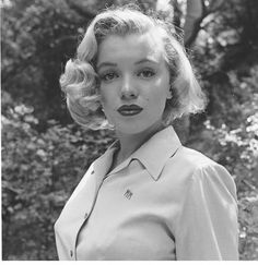 The Top 10 Iconic Queens of Vintage Hairstyles. This is #4, Miss Marilyn Monroe. Her Short bob is worn curled in this picture, an iconic style for the 50s.
