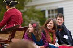 Family enjoying a carriage ride during a visit to Colonial Williamsburg