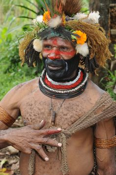 Huli tribe, Papua New Guinea - Tari by World_Discoverer, via Flickr. This man lost a finger in a battle. He picked it up, dried it and used it as a pendent.