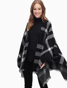 Warm up this winter in our Sterling Poncho 	Classic black and white plaid is chic and sophisticated 	Fringed hem gives a subtle boho-feel 	Open front 	Model is wearing size S. She is 5'8.5'', 32-24-34.5