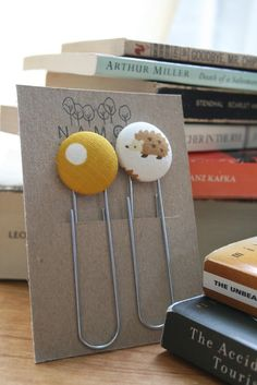 paper clip + embellishment = bookmark. Great bookmark gift packaging idea