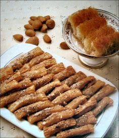 A favorite in South Cyprus is Daktyla, lady fingers filled with ground almonds and cinnamon sugar, a traditional sweet served during Sykoses (a ten day carnival preceding Lent) and Pellomaskes, holiday of the Mad Masks (similar to our Halloween).