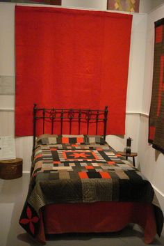 Red flannel quilt from Gorsgoch, Cardiganshire - circa 1880 - the reverse of this quilt is green flannel. And on the bed, the Central Star Quilt from Llanrhystud c 1870.