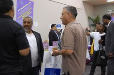 Mark Ress of Blitz Media Marketing along with his son Jezekiah Cordova of Socal Imagery in the background representing at the I.E. Largest Mixer 2011