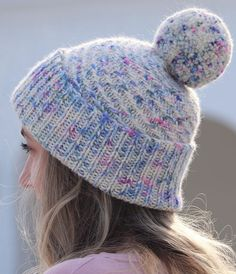 Free Knitting Pattern for Swirled Sprinkles Hat - This beanie features a ribbed fold up brim, a delicate spiral stitch pattern in the crown, and a pompom. Designed by Kaitlin Blasing for bulky yarn on smaller needles.