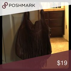 🌻Final Markdown🌻 Brown Fringe Purse from Buckle Used for only a month. Pretty large purse with tons of room inside! No wear or tear. Can be worn in shoulder or cross body with extra strap. Smoke free home 🚬❌ Ships ASAP 📦 Bundle to save 🤑 Open to all offers 🤔 Welcome to my closet! 😘 Buckle Bags Crossbody Bags