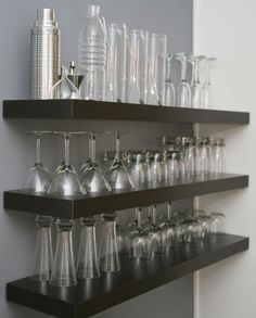 Hang shelves above bar cabinet and display glassware