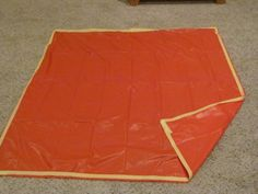And add a rug or towel or plastic table cloth underneath the sensory table. I used a plastic table cloth.