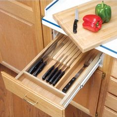 """Combination knife holder and cutting board on full extension slides is designed for 18"""", 21"""", and 24"""" wide base cabinets.  This is a much safer solution than just knife blocks. Would be really easy to just put a safety latch on the drawer and it would be handy to have that cutting board with it! Really good concept!"""