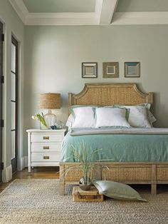 Night stand Coastal style generally uses a soft color palette and texture shines in beach style decorating. Think rattan, thick woven rugs, or distressed furniture pieces. This bedroom showcases both a beach color scheme and layered textures. Tropical Bedrooms, Coastal Bedrooms, Coastal Living Rooms, Coastal Cottage, Coastal Decor, Tropical Decor, Tropical Bedding, Aqua Bedding, Blue Comforter