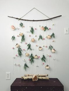 rose flower wall hanging // flower wall backdrop // floral wall hanging // boho wall hanging This rose flower wall hanging is a great addition to give any room bohemian and cozy vibes. It is handmade with artificial roses, greenery, hemp, wood, and is hung with twine. The neutral