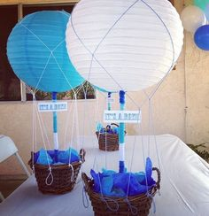 hot air balloons paper lanterns are super cool and adorable. It makes a perfect table centerpiece for baby boy shower party