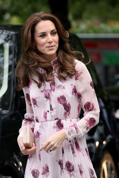 Despite the October chill, Kate looked as if she was dressed for summery weather as she stepped out in London