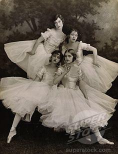 SuperStock - Four ballet dancers performing ballet
