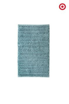 Add a pop of cool blue to one of the most-used rooms in the house with the handwoven Threshold Chunky Bath Rug. In super-soft, this cozy bathroom rug beautifully complements virtually any bathroom décor.