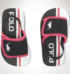"""Shop Toddlers's at RalphLauren.com, the Official Site of Ralph Lauren. Ferry Slide II Sandal - This comfortable sandal features convenient EZ styling and our signature embroidered pony. Slide silhouette. Slip-on styling. Hook-and-loop strap closure ensures easy on and off. """"Polo"""" screen-printed at the sole. Foam insole. Treaded rubber outsole. Our signature embroidered pony accents the toe. Rubber. Foam. Imported."""