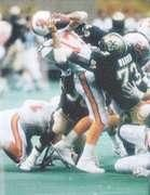 Long-time Saint Frank Warren takes down Chris Chandler of the Buccaneers in 1991 action in the Louisiana Super Dome. In this game Frank accounted for 2.5 of the Saints 6 sacks on the day.  In 1991 the Dome Patrol was at it's highest point ranking #! that year in point given up and turnovers and #2 in yards given up. The New Orleans Saints defense also had 50 sacks on the year.