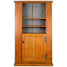 c1790 18th Century American Pine Slant Back Cupboard | From a unique collection of antique and modern cupboards at https://www.1stdibs.com/furniture/storage-case-pieces/cupboards/