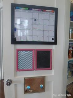 Mommy command central: family calendar, memo board, weekly menu, and kid-level mirror for applying sunscreen.