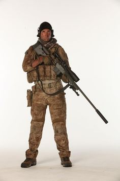 This is U.S. Navy SEAL sniper class  Teir 1 sniper holding a McMillian Tac-300