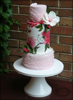 Ruffles, hand-painted birds and flowers, soft colours and big sugar flowers. Lovely cake.