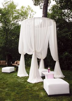 Hoop it up!  Hang a large hoop over a comfortable sitting are for a great summer party atmosphere.