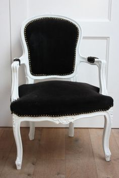 anyone have any idea where i can find an old chair like this to refinish/recover?!