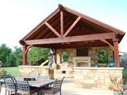Craftully Built Stonework Large Outdoor Kitchen and Seating Area