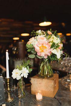 centerpiece on a wooden block - photo by Ashley Caroline http://ruffledblog.com/garden-inspired-wedding-at-brooklyn-winery #centerpieces #weddingflowers