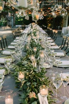 I really like adding greens and vinery to the table. I do not like any wood elements,so I think green is good to balance the blues, creams, and clears of the flowers and vases and candles.