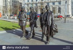 Download this stock image: Beatles Statues in front of of the Liver buildings at the Albert Dock in Liverpool - hp2cxg from Alamy's library of millions of high resolution stock photos, illustrations and vectors.