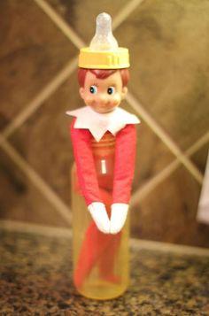 Elf ideas and elf on shelf antics. Elf on shelf is inside of baby bottle.