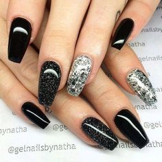 Black nails ideas | allthestufficareabout.com black Nail Designs, black nails, acrylic nails, coffin nails, square nails, nail design, simple matte nail design, glitter nails, shellac nail, nail polish, color nail design, glitter nail design, classy nails, almond nails, round nails, short nails, long nails, nail art, nail ideas, long nails, Opi nails, silver nails, elegant nail art, sparkly nail almond black nails with glitter