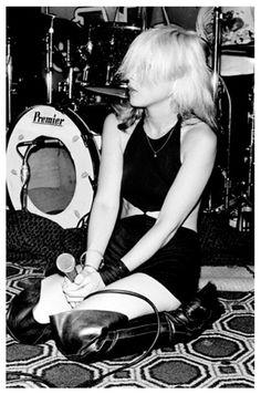 Debbie Harry kneeling, on stage with Blondie at the El Mocambo Club, Toronto, 1978.