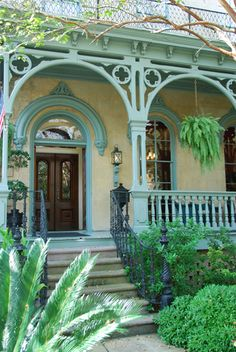 Ornate woodwork on the porch trim & beautiful lace iron railing leading up the steps. Victorian Porch, Victorian Homes, Victorian Cottage, Victorian Architecture, Architecture Details, Porch Architecture, Decks And Porches, Front Porches, Porch Veranda
