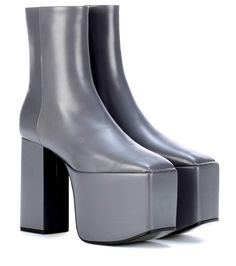 f942a08d6de Balenciaga brings the classic ankle boot to new heights of drama this  season with this plateau-sole style. Crafted from all-over smooth grey  leather