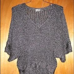 """Studio Y Silver Sparkly Dolman Sweater Sz M Studio Y black and silver knit butterfly sleeve short sleeve sweater size medium.  Made in China.  55% acrylic 45% polyester.  In excellent condition.  Measurements: Chest:  19-20""""  across the front Waist:  16-17""""  across the front Total Length:  24"""" Studio Y Sweaters"""