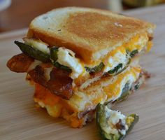Jalapeno Popper Grilled Cheese Sandwich Ingredients 2 Jalapenos sliced lengthwise seeds and membranes removed 4 ounces cream cheese 4 slices bacon crispy cooked 2 slices monterey jack 2 slic… Jalapeno Poppers, Jalapeno Grill, Jalepeno Popper Grilled Cheese, Cheddar Cheese, Jalapeno Popper Burger Recipe, Cheese Dips, Cheese Plates, Cheese Ball, Grilled Cheese Recipes