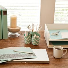 Use simple and stylish office supplies to organize your desk and make it your own, like these trays from seejanework.com.